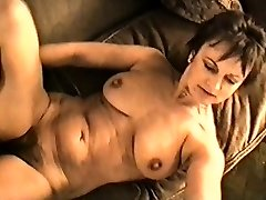 Yvonne's immense mammories hard nipples and hairy pussy
