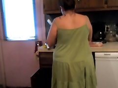 Mom Upskirt prepping dinner (sexy green dress and panties)