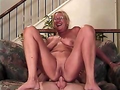 Mature blonde with glasses deep-throats a manhood