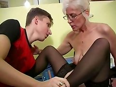 Mature with Silver Hair Glasses and Pantyhose Wakes the Boy