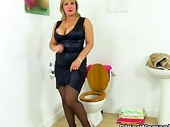 British cougar Danielle gets turned on in bathroom
