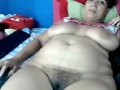 Mom Yasmine 46 toying on home webcam