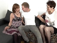 Whorey matures are wearing erotic stockings while having a threesome with a younger boy they like