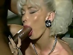 Vintage Big-boobed platinum blond with 2 Big Black Cock facial