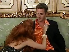 Ginger-haired bitch Eva Falk in vintage orgy