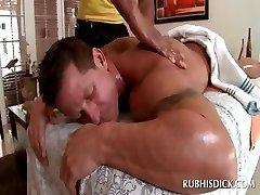 Muscled stud rewarding his gay masseur with a blowjob