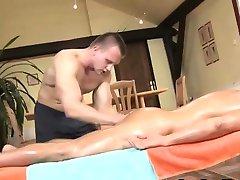 Muscly masseur rubbing client