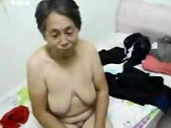 Asian Grannie get dressed after fuck-fest