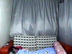 Asian teenie undressing on webcam