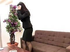 Girl in suit and stockings milks when she is alone