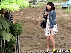 Embarrassed asian pissing