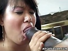 Black dude has a torrid Asian chick to ravage