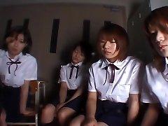 Four Japanese college girls slobbering on teacher
