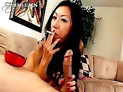 Tia Ling likes to fellate on a cigarette and a rock hard cock at once