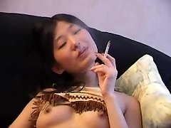 Asian Smoking Bare on Bed