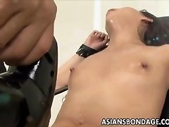 Asian stunner bond and fuckd by a pounding machine