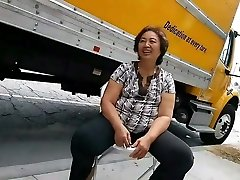 Asian granny woman bending over then chatting and smiling