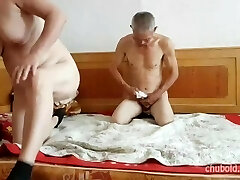 Handsome Chinese grandpa giving drilling