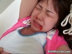 Cute young asian babe is trussed part1