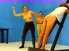 Caned by 2 dominas until he bleeds