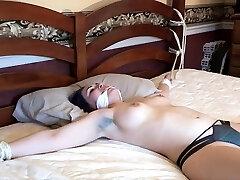 Brunette bdsm amateur victim tied up by master