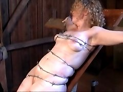 tied with barbed wire, crushing soft tit and pussy meat