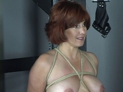 Nude sandy-haired with nice tits and ass is whipped in bdsm dungeon