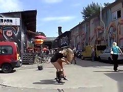 German babe gets string bondage in public