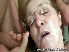 Horny granny gets facial from men