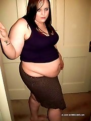 BBW with a big belly posing for the camera