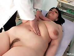 Gynecology specialist examines saggy tittied brunette