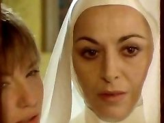 Nun seduced by girly-girl!