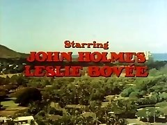 Classic porn with John Holmes getting his big cock deep-throated