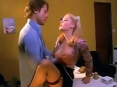 Pretty blonde secretary in stockings fucked on the desk