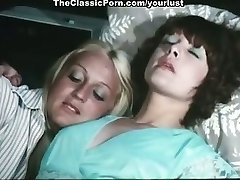 Two lesbians Cathy Stewart, Diane Dubois fondle each other and pummel coochies with toys