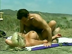 Old-school Hugetitted Babe Banged on Beach