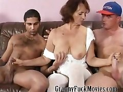 Granny with rock hard tits fucking two