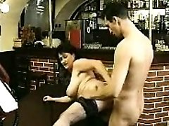 Brunette in stocking sucks yam-sized cock and fucks it