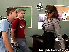 Big-breasted teacher in glasses fucks her favorite students