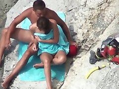 The couple was caught while masturbating on public beach