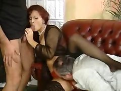 Redhead milf orgy with 3 men on the sofa