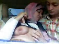 Arab Hijab Girl sucked Big Boobs and kissed in Car