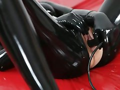 Mia Lana in latex catsuit