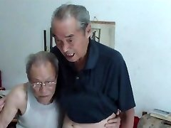 Chinese aged fellows comparing cocks
