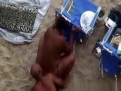 Nudist black couple snooped tearing up in beach