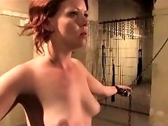 Redhead is chained, whipped, and pinch