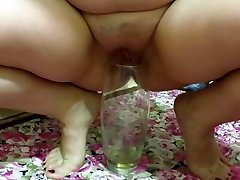 milf, pissing in a vase