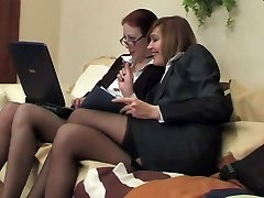 Two business ladies in pantyhose