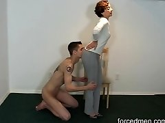 Naked slave licks mistress' legs for worship