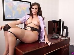 Oversexed secretary Charlie Rose takes off skirt and shows off her jugs